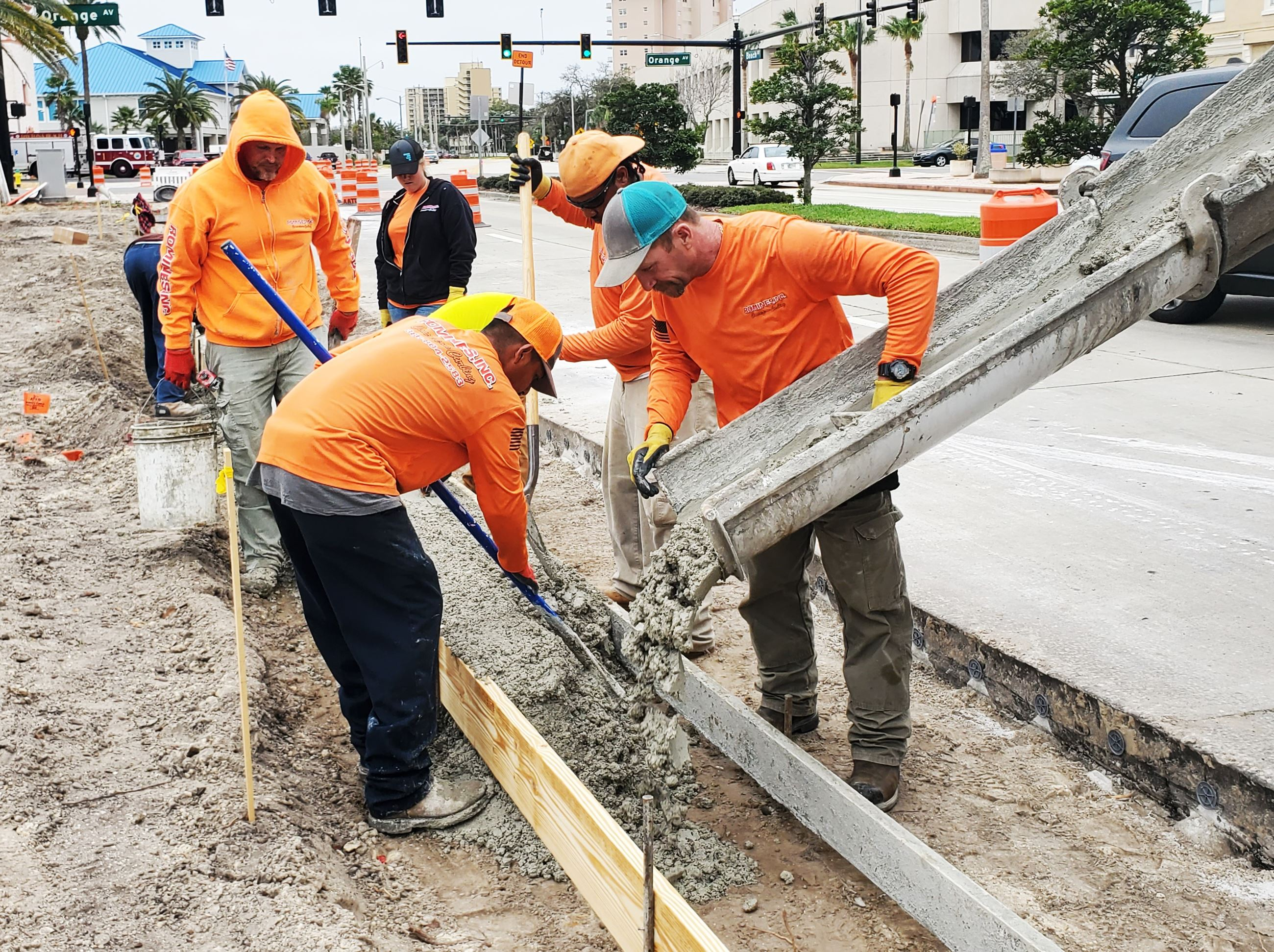 Workers pouring concrete on Beach Street