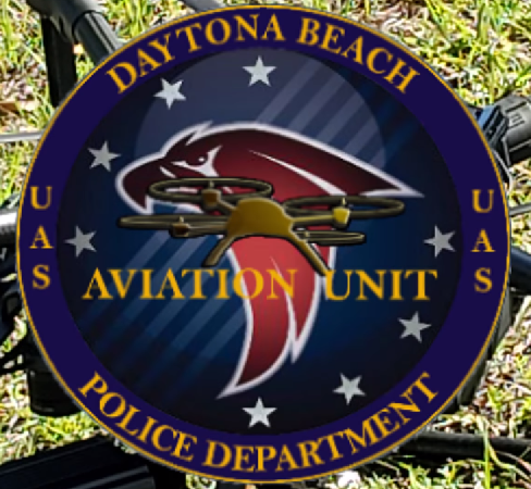 UAS unit logo with drone in background